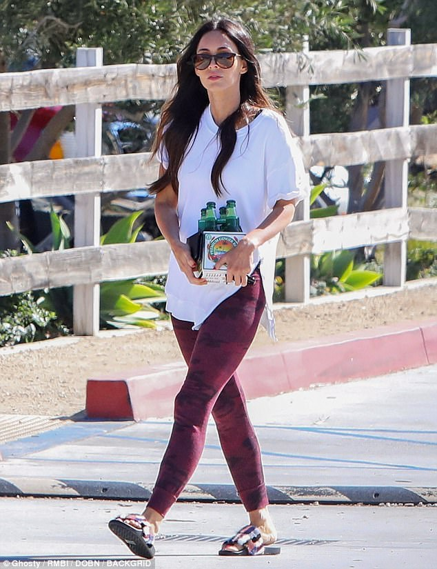 Love those legs: Megan Fox showed off her pretty pins inburgundy tie-dyed leggings and a white T-shirt when she went on a special run for a four-pack of ginger beer in Malibu Saturday