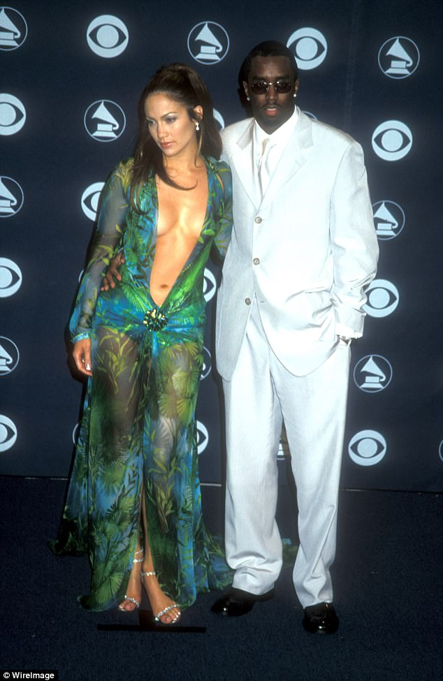 A new man: As Puffy the rapper scored himself a superstar girlfriend - Jennifer Lopez aka JLo; the power couple are seen in 2000