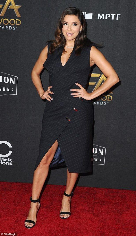 Fashionista: Eva Longoria, 42, put her best foot forward in a pinstripe wraparound dress and black sandal stilettos