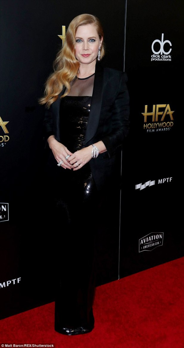 Shining star: Amy Adams, 43, shimmered in a black gown with a tuxedo jacket and wore her burnished locks  in loose waves. She added stunning diamond earrings, rings and a bracelet