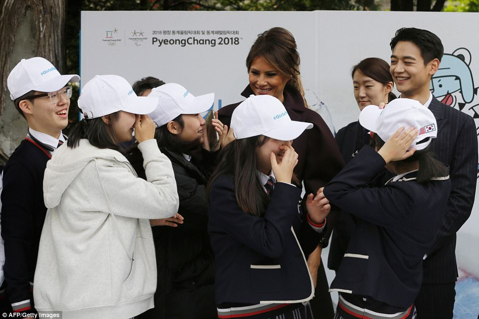 Melania smiles as she speaks with South Korea children, hoping to encourage more of them to take up sport ahead of the 2018 Winter Olympics which will be held in South Korea