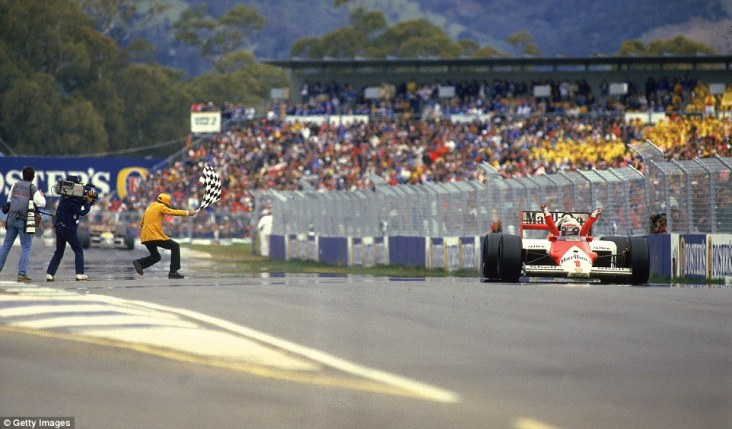 ...except that Williams feared what happened to Mansell could happen to Piquet, so through precaution pitted the Brazilian. That allowed Prost into the lead and despite Piquet's fresher tyres he couldn't close in fast enough to pass the Frenchman. The McLaren driver celebrates his victory and title win, with Piquet's Williams just over four seconds down the road