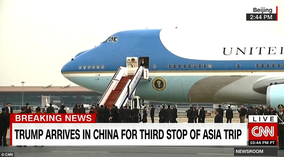 Chinese officials rolled a large set of stairs to the aircraft's door on Wednesday, avoiding any appearance of the kind of insult that greeted former president Barack Obama in 2016
