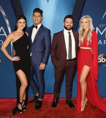 Teamwork! Dan Smyers was joined at the hip with his wife Abby Law, while Shay Mooney had his arm wrapped around wife HannahBillingsley