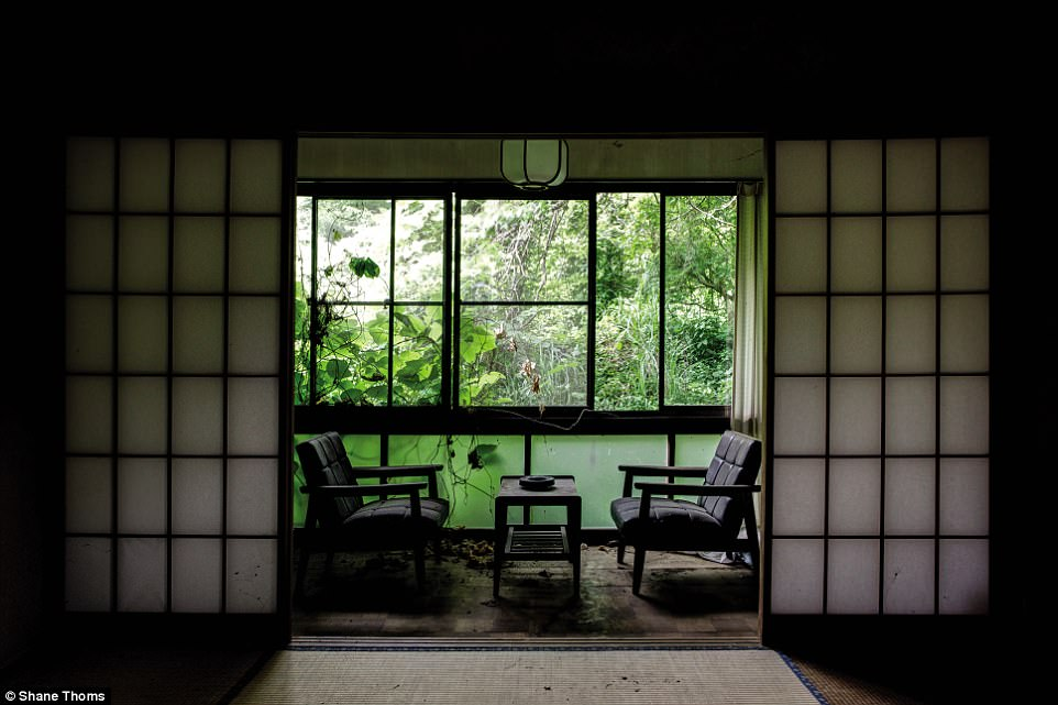 An abandoned hotel in Ibaraki Prefecture: 'Located beside a stream in a quiet country town, this quaint establishment was filled with fully furnished albeit rotting tatami rooms,' says Thoms