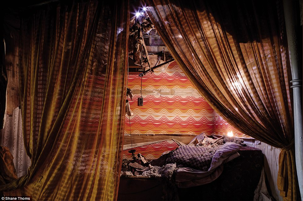 This room in the Love Hotel had a Moroccan/Middle Eastern theme with tattered scarves and drapes surrounding a heavily decayed bed