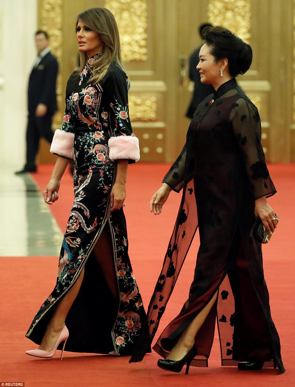 Wowing: Melania Trump once again stepped up her fashion game during a state dinner in Beijing on Thursday, donning an ornate Gucci fur trim dress with an ornate pattern inspired by traditional Chinese clothing