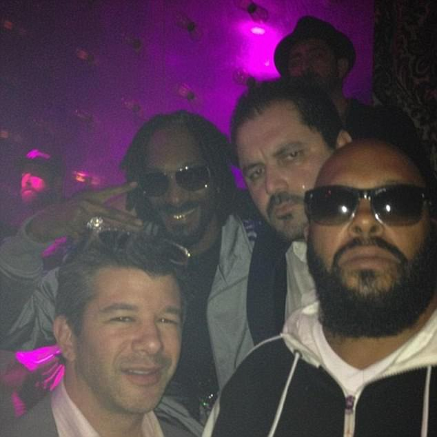 Partying: Pishevar and his friend Travis Kalanick were photographed in 2012 with Snoop Dogg and Marion 'Suge' Knight
