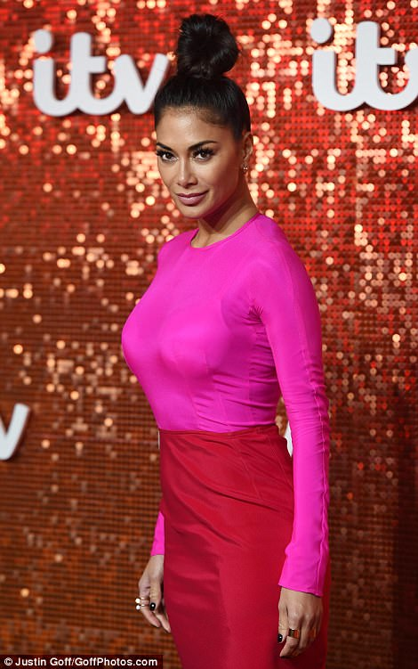 Stealing the show: The X Factor judge looked incredible in her colour-block ensemble, which she complemented with minimal make-up and a dramatic topknot
