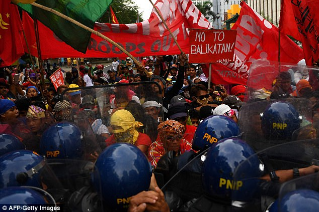 Hundreds of left-wing activists in Manila marched on the US embassy to protest US militarism