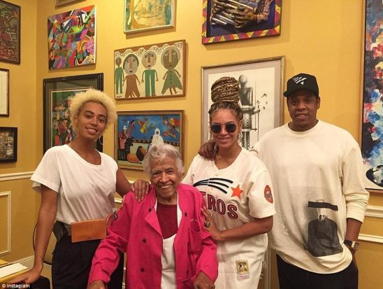 Family time: Beyonce in an Astros shirt with Jay as well as her sister Solange in New Orleans as they talk to a friend on Wednesday