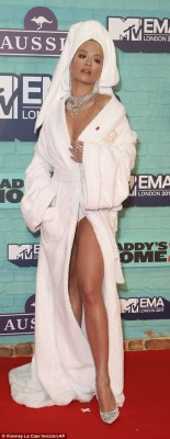 Is she having a bath? No one stood out more on the red carpet than the show's host Rita Ora, who seemed to have forgotten her ensemble for the evening as she arrived in a white robe and towel on her head