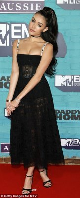 Sexy: Singer Madison Beer put on an eye-popping display in a plunging corsetted semi-sheer black dress, which boasted logo-clad straps