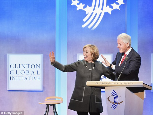 Former US Secretary of State Hillary Clinton (left) and husband, Former U.S. President Bill Clinton (right) at the Clinton Global Initiative in 2014 in New York