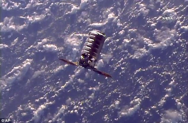The Cygnus cargo spacecraft moves towards the International Space Station, Tuesday, Nov. 14, 2017, 260 miles (418 kms.) above the earth. the capsule contains nearly 4 tons of cargo. It's named the S.S. Gene Cernan in honor of the last man to walk on the moon, who died in January.