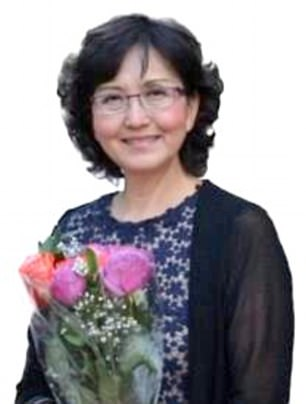 Jianhua Qin, 55, an estate agent from Cary in North Carolina, became trapped under the wheel of the hire car when her husband Li You took his foot off the brake and failed to apply the handbrake