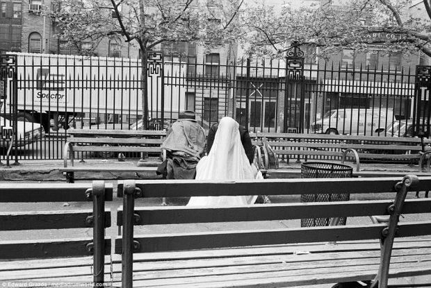 Men with sheets draped over their heads attempt to get some sleep in the public garden between Chrystie Street and Forsyth Street on the Lower East Side in 1975