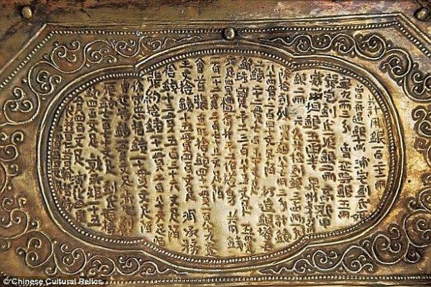 Inscriptions carved into the protective stone chest as well as into the model shrine tell the story of how Buddha's skull bone came to lie in the tiny golden chest within