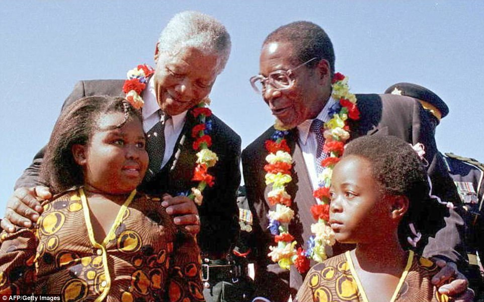 First heralded as a liberator who rid the former British colony Rhodesia of white minority rule, Mugabe (pictured above with Nelson Mandela) was soon cast in the role of a despot who crushed political dissent and ruined the national economy