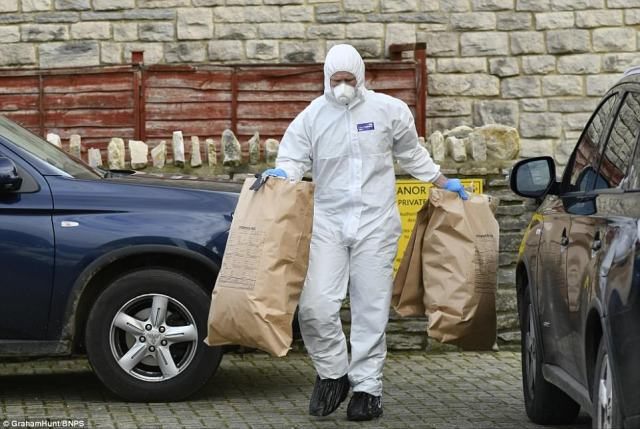 Forensic investigators are pictured carrying equipment to scour the home of Rosemary Dinch, 71, in Manor Gardens, Swanage