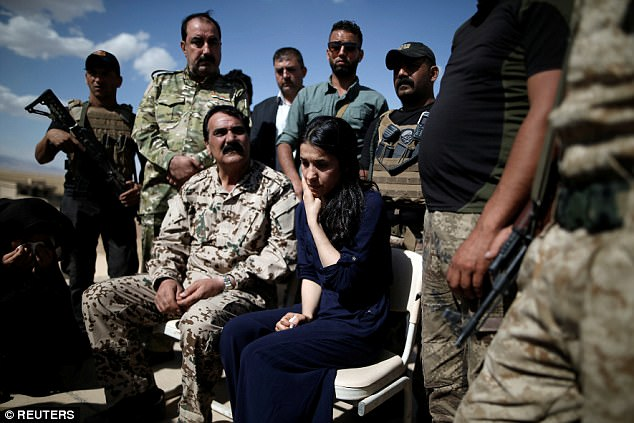 Murad was abducted at age 21 from the village of Kocho near Sinjar, an area that is home to about 400,000 Yazidis, by hard-line Sunni Muslim fighters who view Yazidis as devil worshippers (Pictured, Muradreacts as she visits her village for the first time since being captured, June 2017)