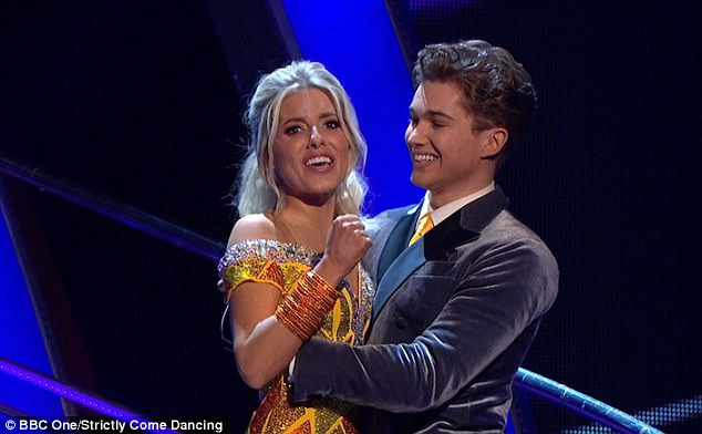 Crunch time: Mollie and AJ, who have been the source of swirling romance rumours, looked tense as they waited alongside the other dance couples to await their fate