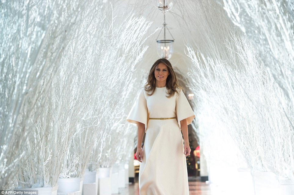 First lady Melania Trump was told by one of her young guests that she looked 'like an angel' as she invited youngsters to the White House Monday as part of the Christmas decorations reveal