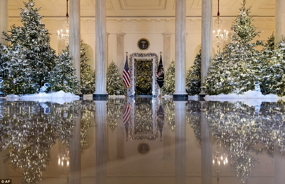 The Grand Foyer and Cross Hall are decorated with a 'Nutcracker Suite' theme - the first the White House ever used - with this year's theme being 'Time-honored Traditions'