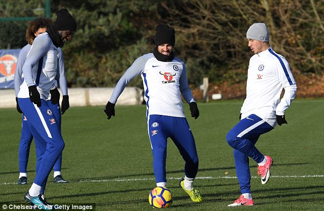 Cesc Fabregas (centre) is all smiles as he trains alongside Eden Hazard (right)
