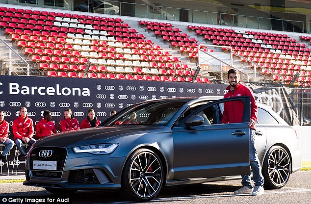 Star striker Suarez went for the same model as Messi but in a different colour - Daytona Gray