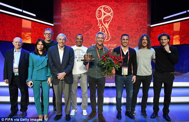 Brushing off accusations of hypocrisy, Lineker said he would not have taken the job if disgraced former Fifa chief Sepp Blatter had not been ousted in 2015. Above, the ex-England captain even blew out the candles of a cake to mark his 57th birthday, which was presented to him by his Russian hosts