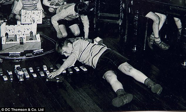 Francis McColl, playing with cars on the floor, at the nursery of Smyllum Park. The boy died after a member of staff hit him on the head with a golf club