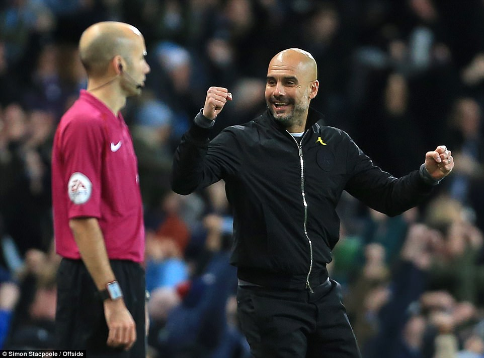 Pep Guardiola cheers as he again watches his City side snatch the three points late on as they regain their eight point lead