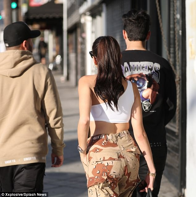 Guy pals: The Clearasil spokesmodel - who previously romanced Brooklyn Beckham and Jack Gilinsky - was joined at Jon & Vinny's by two mystery male companions