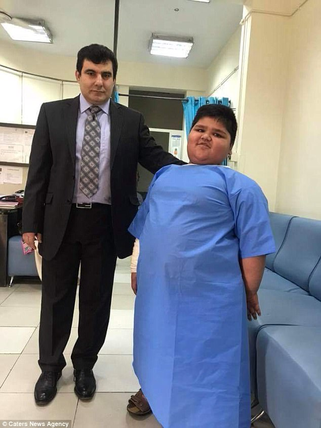 His parents say they want to see him playing and not in pain (pictured with his surgeon)