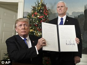 Trump signed, Pence smiled: The vice president is a figurehead for evangelicals