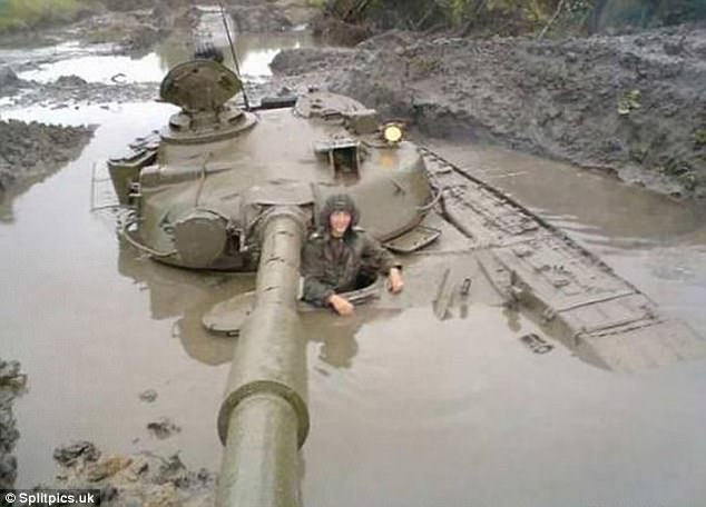 Sinking feeling: One recruit seems to have misjudged just how soft the terrain was after seeing their battle tank all but submerged into a muddy pool