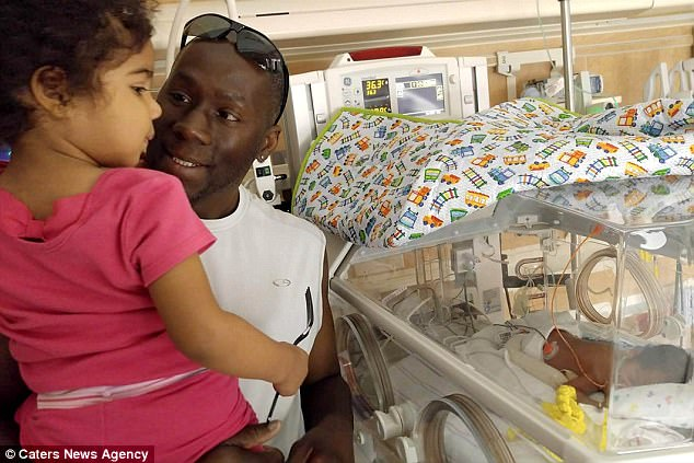 New additions: Victor takes three-year-old daughter Zoey to meet her siblings in hospital