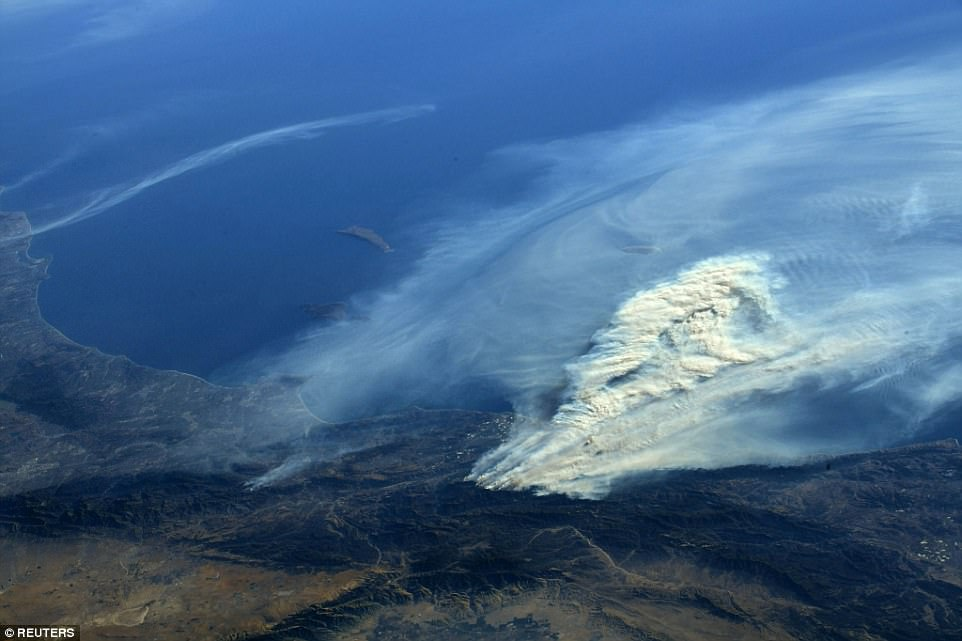 Smoke is being clown out over the Pacific ocean in this beautiful - but terrifying - photo. Bresnik added: 'Thank you to all the first responders, firefighters, and citizens willing to help fight these California wildfires'
