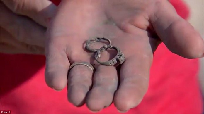 Even thought the couple lost most of their belongings, they stumbled upon Donna's mother's wedding rings in the dirt. Donna said she plans to keep the rings (pictured) 'for the rest of my life'