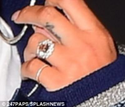 The rock looked to have a big diamonds around a champagne diamond