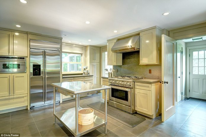 Gourmet kitchen: Stone tiled, it features top-of-the-line stainless steel equipment including a range and large fridge-freezer