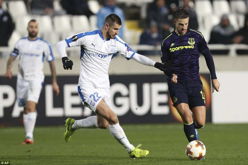 Kevin Mirallas charges forward with possession as Apollon's Valentin Roberge sets off in pursuit of the Belgian
