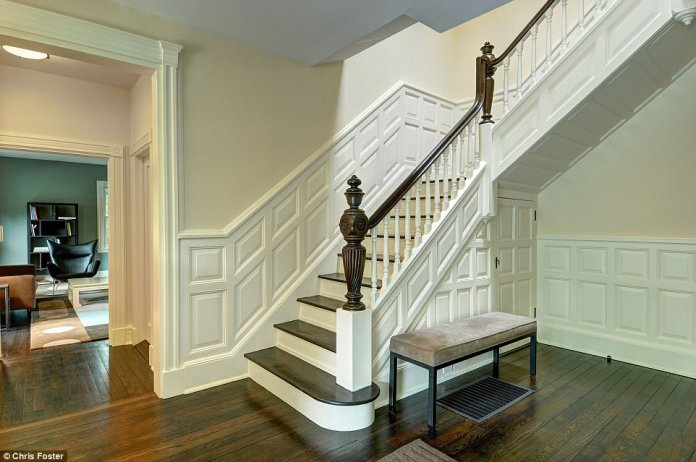 Stairway to heaven: Originally listed for $2.95 million, the property's last asking price was $2.49 million, and it includes beautiful period details such as this hand-carved wood staircase balustrade