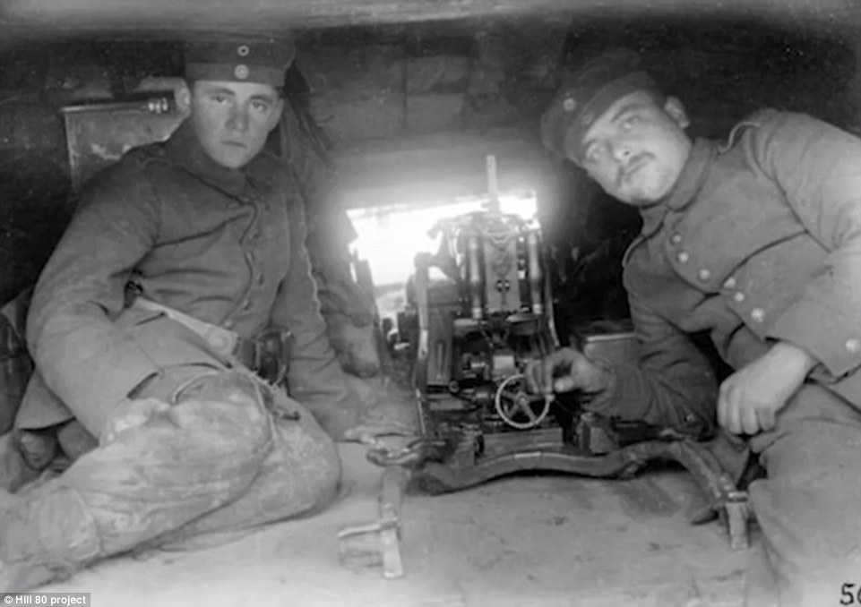 Two German soldiers man a gun in the trenches at the Hill 80 outpost which overlooked Ypres. The position was taken in 1917