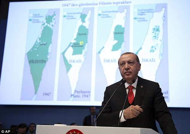Turkey's president Recep Tayyip Erdogan has announced his country intends to open an embassy in East Jerusalem, where Palestine wants its capital to be. He is pictured at an extradonary summit of the Organisation of Islamic Cooperation in Istanbul this week