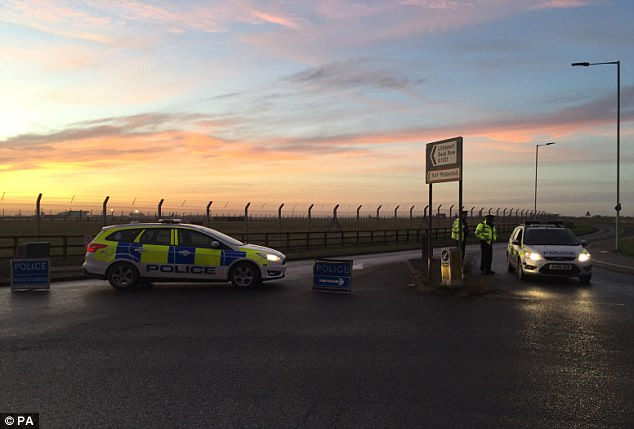 The base was put on lockdown amid reports of a car being rammed into a checkpoint