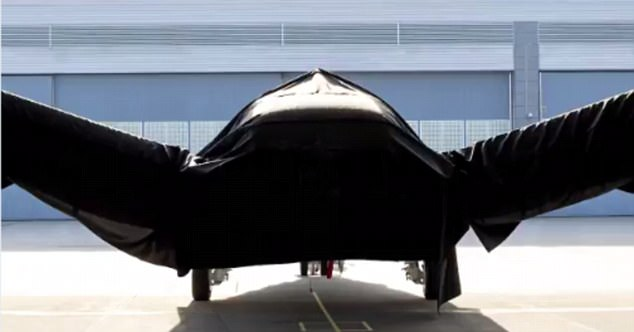 The craft, seen hidden under a cloth, was at first believed to be a radical new craft using electric 'hairdryer' to allow it to land and take off vertically.