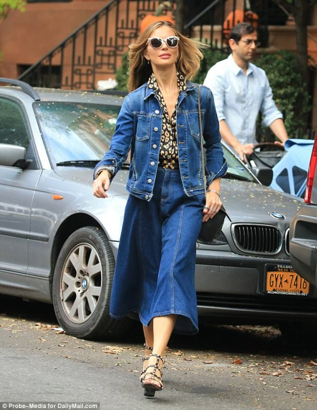 A confident Chapman is seen for the first time leaving their family home in New York amidst her husband's sexual allegations in October