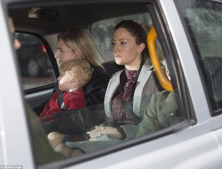 The wife of Lord Nicholas, Lady Paola, (left) was pictured holding their youngest son Louis in the back of the taxi